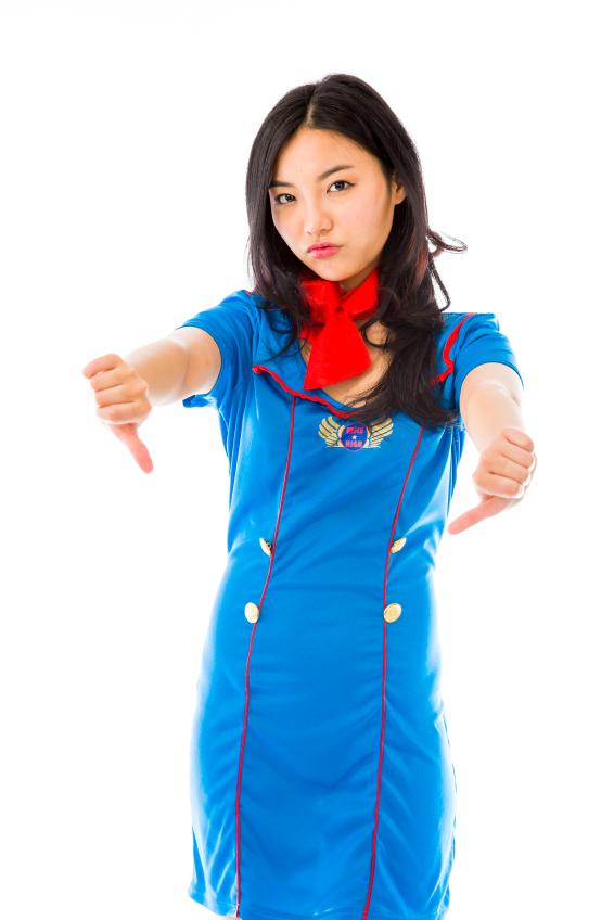 Unhappy Asian air stewardess giving thumbs down gesture