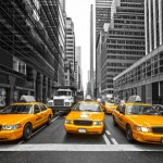 Taxis and a dump truck in the city