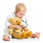 Baby with stethoscope and bear